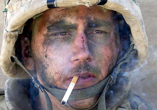 Photo of a solder smoking after battle.