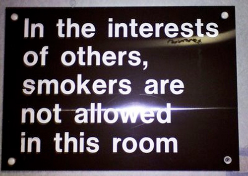 Sign forbidding smokers from enter a hospital room.