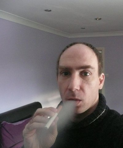 Karl enjoys a vape as he blows out vapour from his e-cigarette