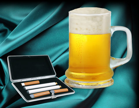 E-cig kit next to a pint of beer.