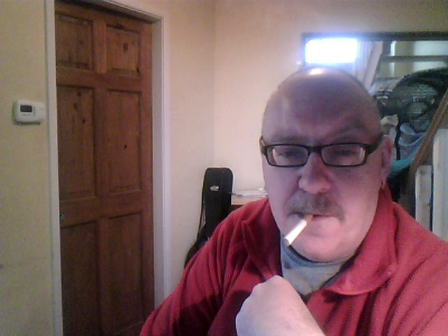 Leo Roberts vaping an electronic cigarette.