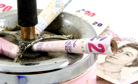 Rolled up notes in an ashtray.