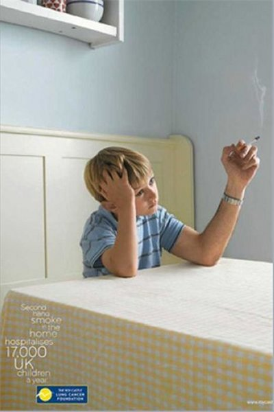 A child smokes in this anti-smoking poster.