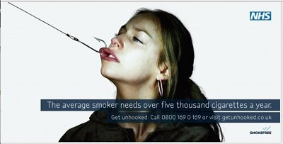 A hook pulls the mouth of this smoker towards the camera in this NHS stop smoking ad.