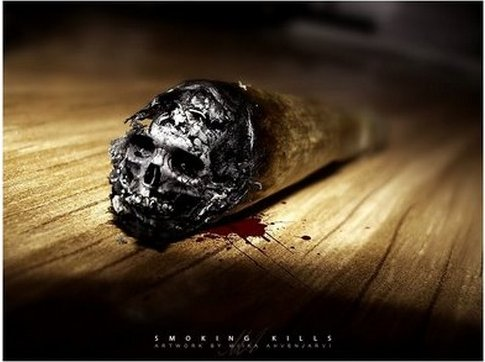 A skull forms at the end of a cigarette.