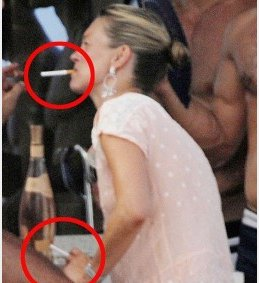 Kate Moss vaping.
