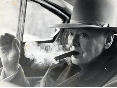 Churchill puffing on a cigar.