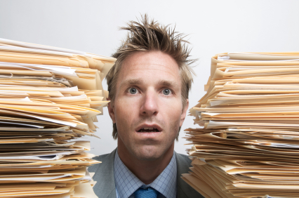 A man surrounded by papers.