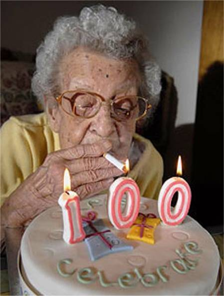 Women lights up cigarette from her 100th birthday cake.