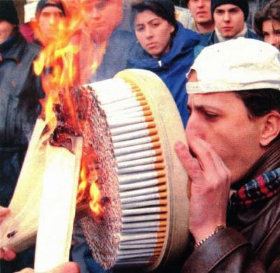 A man attempts to smoke hundreds of cigarette in one go.