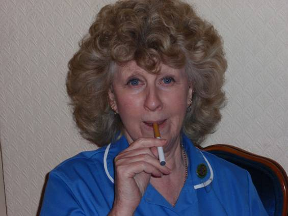 A nurse with an electronic cigarette.