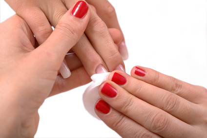 Nail polish being removed with acetone.