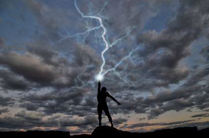 Lightning strikes the upraised hand of a man.