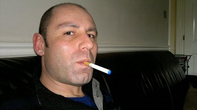 Stephen Clark with a blue tipped electronic cigarette battery.