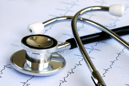 A stethoscope on the top of an EKG chart.
