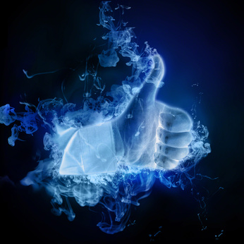 A hand wrathed in blue smoke gives the thumbs up.