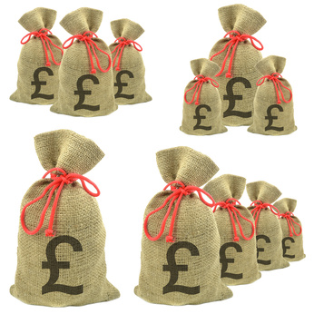 Bags of money with Pounds currency on a white background