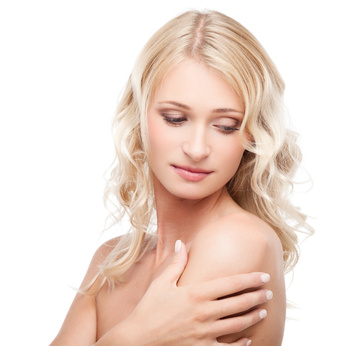 A slim young lady hugs her chest.