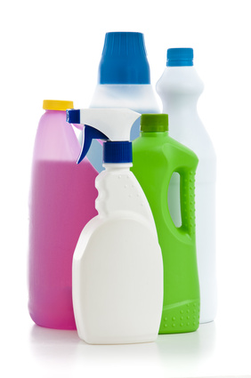 Coloured bottles of cleaning products.