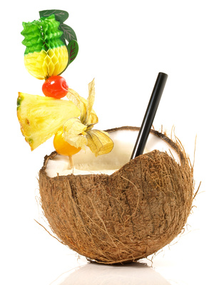 Pinapple and rum in a coconut.