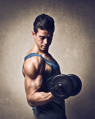 A man shows off his muscles as he lifts weights.
