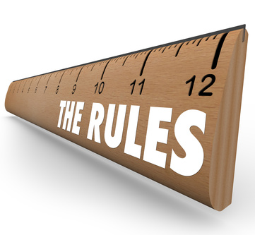 "Ruler with text ""The Rules"" written on in white."