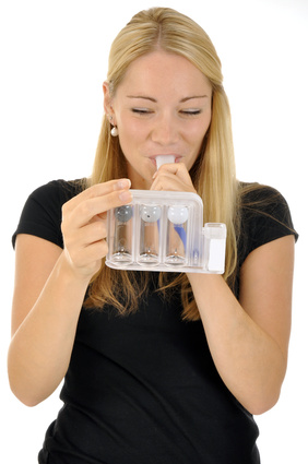 A women inhales from a plastic container.