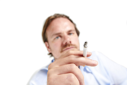 A man holds a cigarette to the camera.