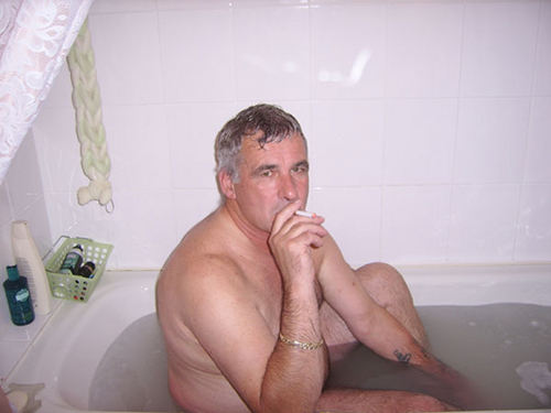 Enjoying an electronic cigarette while having a bath.