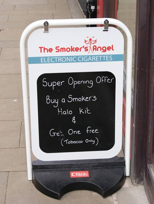 The sandwich board with special offers outside the shop.