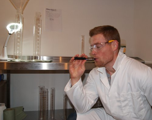Gwyn vapes in the ecigarettedirect lab.