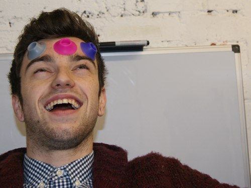 Dan with three coloured ecig suction cups attached to his forehead.