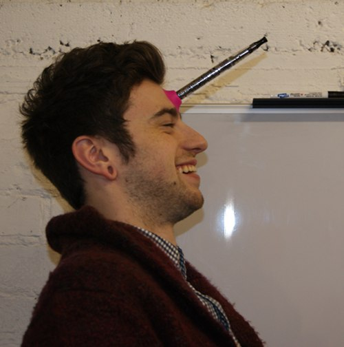 A suction cup with an electronic cigarette on Dan's forehead.