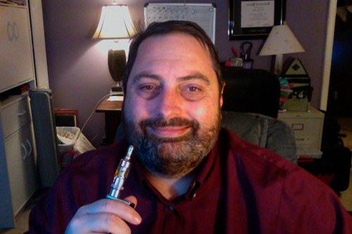 Headshot of a bearded Steve with ecig.