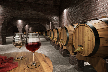 Wine maturing in barrels in a wine cellar.