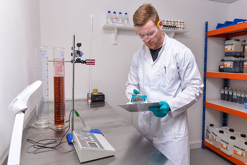 A pharmacologist tests eliquid in a lab.