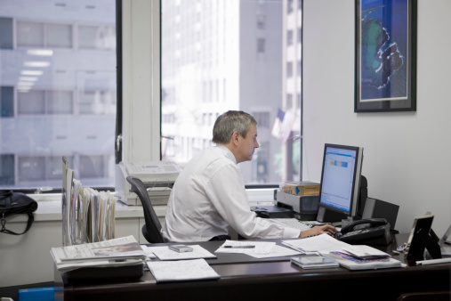 Man in office at computer.