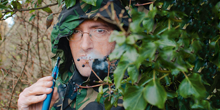Stealth vaping in camouflaged clothing