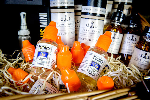 Hamper filled with Five Pawns and Halo E-liquid.