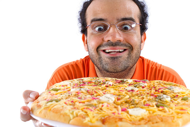 Stoned man holding a pizza