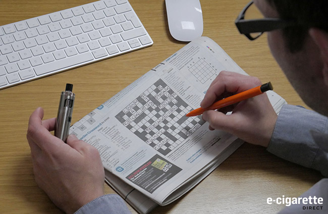 Man Vaping while attempting a Crossword