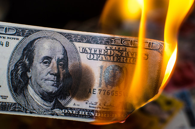 Image of burning money.