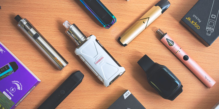 A colllection of vape starter kits on a table.