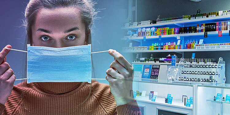 A woman holds up a face mask in a vape shop.