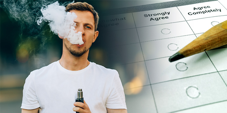 Man vapes next to a survey with a pencil on top.