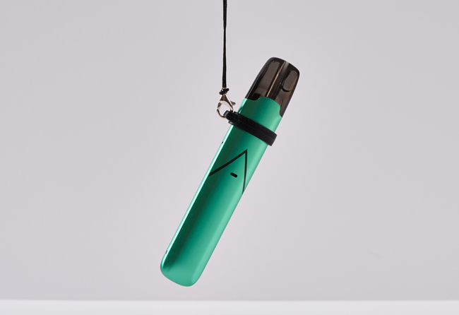 Green Hexa Pro hanging from a lanyard.